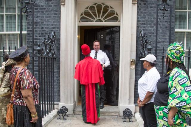 London: A delegation hands in 'Stop The Maangamizi' Petition at Prime Minister's Office, 10 Downing Street on 1st August to counter Afrikan Holocaust (Maangamizi) denial and demand holistic reparatory justice for the Afrikan Holocaust.