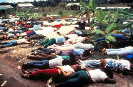 FILE - This November 1978 file photo shows the bodies of Peoples Temple mass suicide victims led by Jim Jones in Jonestown, Guyana. Dozens of Peoples Temple members in Guyana survived the mass suicides and murders of more than 900 because they had slipped out of Jonestown or happened to be away Nov. 18, 1978. Those raised in the temple or who joined as teens lost the only life they knew. They have journeyed over the past 40 years through grief over lost loved ones, feeling like pariahs, building new lives and, finally, acknowledging that many had a role in enabling the Rev. Jim Jones to seize control over his followers. (AP Photo/File)